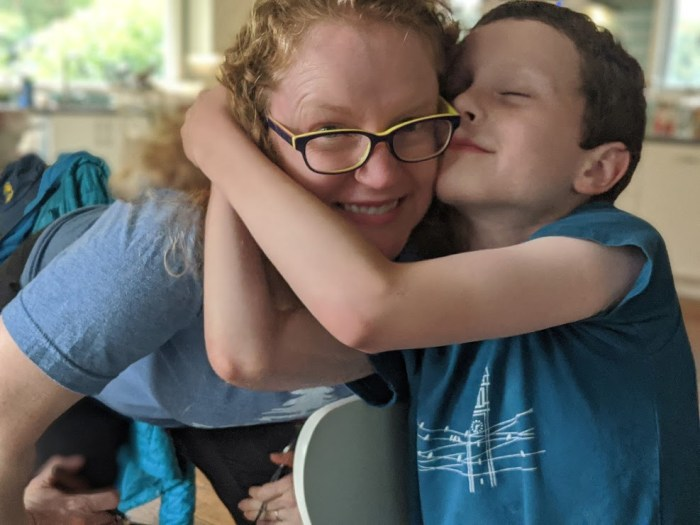 mom and kid hugging