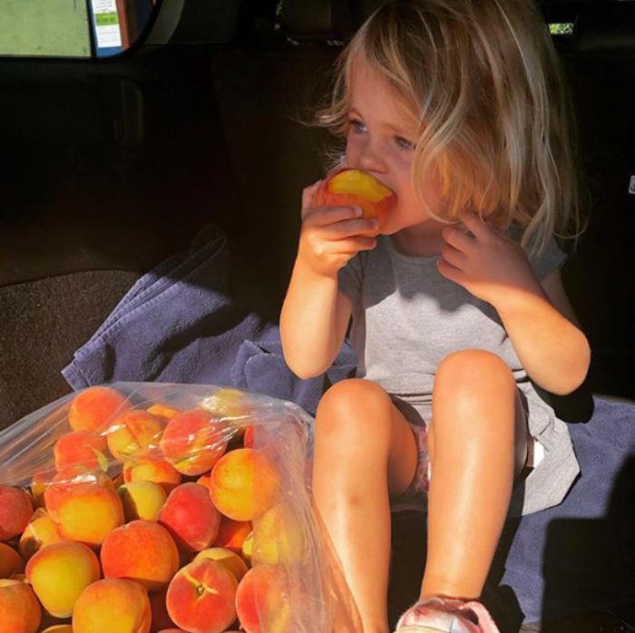 child eating peaches
