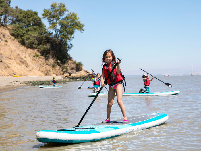 girl on stand up paddleboard