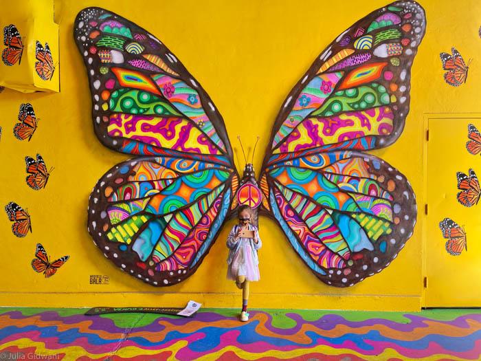 Visiting iconic murals in San Francisco's Umbrella Alley. | Photo: Julia Gidwani