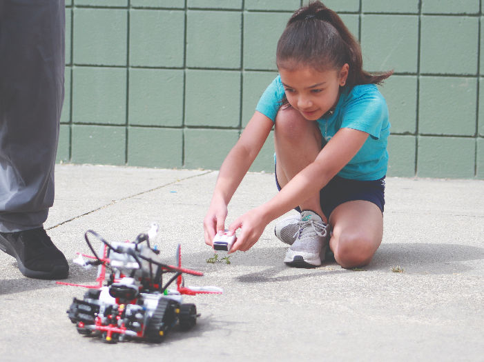 wonder robotics and girl programmer