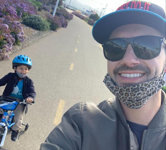 boy biking dad