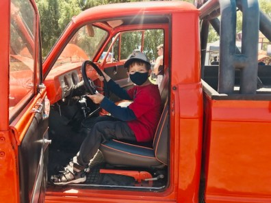 child in truck