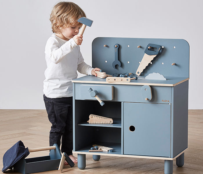 tool bench with toddler playing