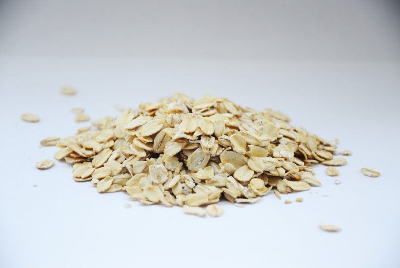 pile of oatmeal grains on white table