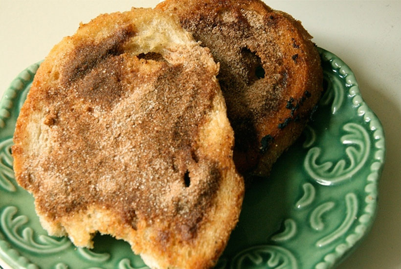 2 pieces of cinnamon toast on green plate