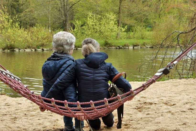 grandma and granddaughter on swing 5 dog farm