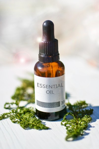 bottle of essential oil 5 dog farm