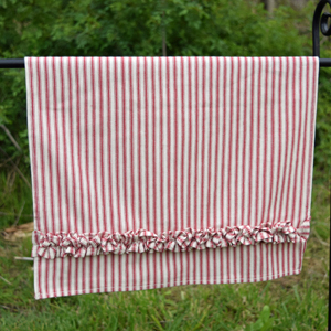 red ticking towel on stand