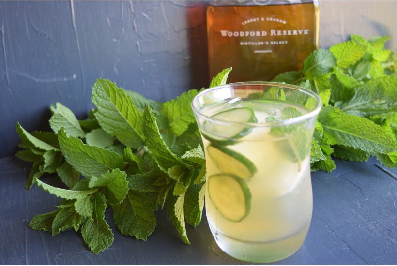 bourbon drink with Woodford Reserve bottle and mint leaves