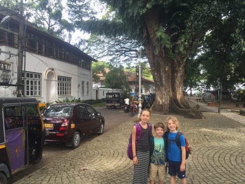 "Historic architecture of Fort Cochin. The kid wanted to do this ""not-back-to-school"" photo."