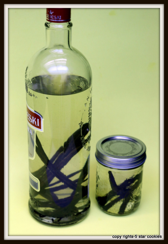 Vanilla Extract Homemade from the best food blog 5starcookies - put vanilla beans into the bottle in front of green wall