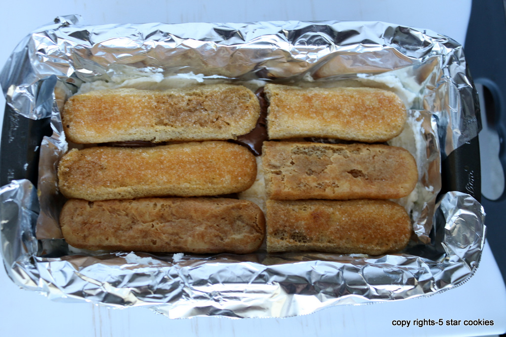 tiramisu from the best food blog 5starcookies -second layer of ladyfingers