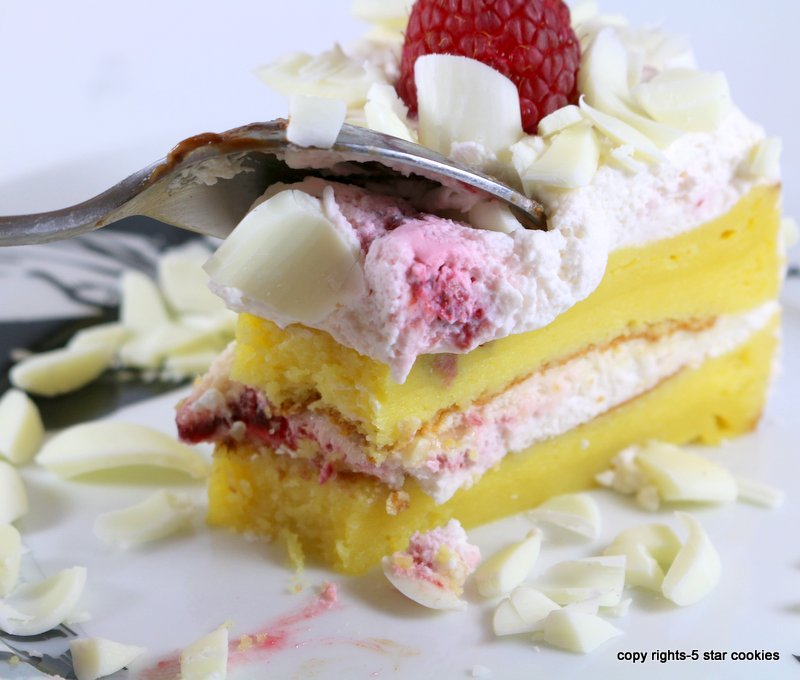 Raspberry White Chocolate Lemon Flourless Torte 5starcookies -cut your piece and enjoy