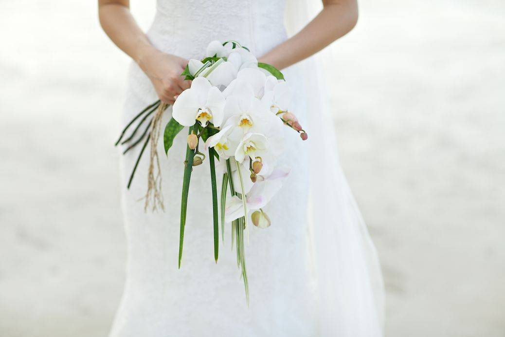 Gorgeously fragrant orchids add luxury to your white wedding. Photo: Outside the box wedding