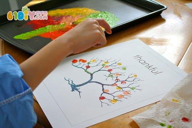 指印畫美麗的樹_手印畫_巧巧手幼兒手工網