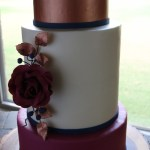burgundy and rose gold wedding cake