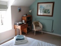 Guests in this extra room can make a cuppa, and share the breakfast and bathroom facilities in the guest suite.