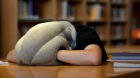 The Ostrich Pillow Mini Arms you With Comfort for Napping