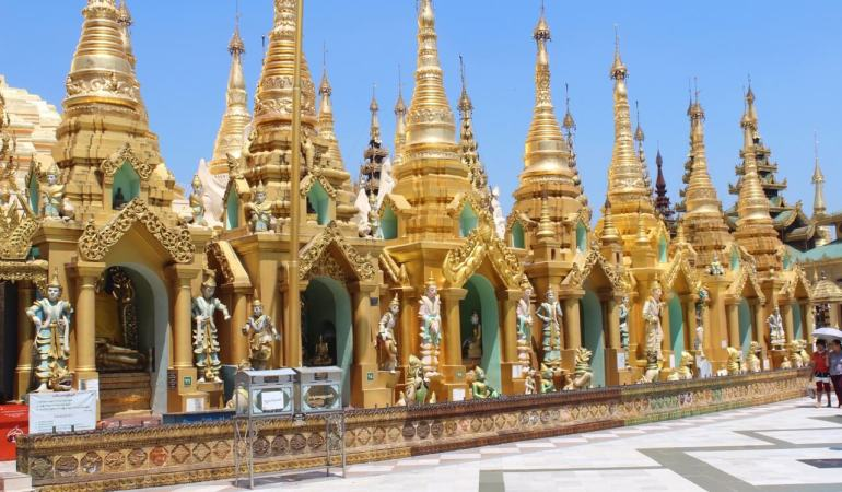 The small stupas and Buddhas images that surround the main stupa, Shwedagon Pagoda, Yangon, Myanmar.