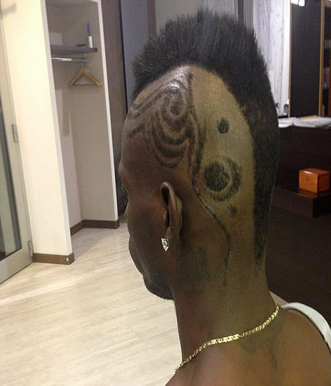 A cut above: Balotelli shows off his haircut... and is it his sharpest look yet?