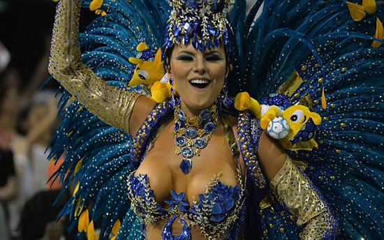 Golden balls! Ronaldo stars in shimmering Carnival parade in Sao Paulo that pays tribute to the striker in nod to World Cup