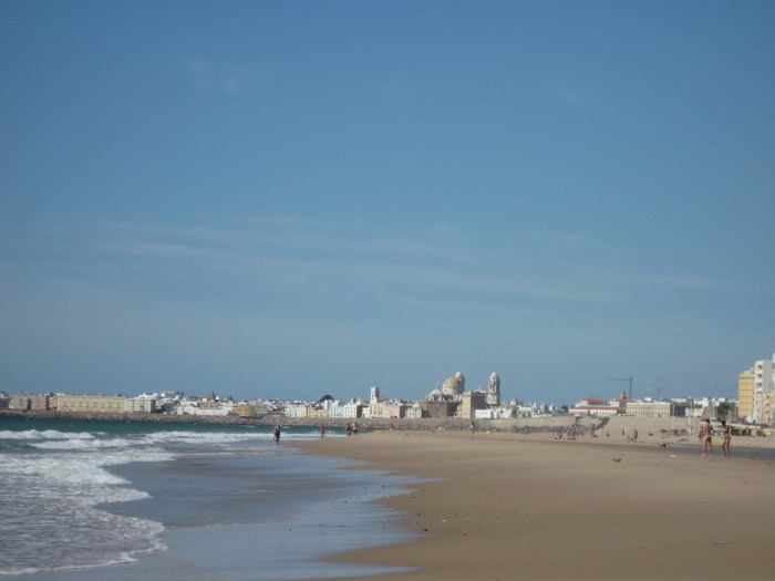 View a famous cathedral from the beach? That's why we love Spain.