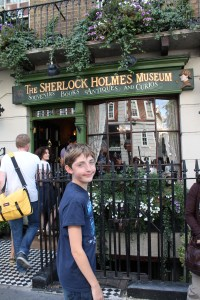 The author's son smiling in front of the Sherlock Holmes Museum