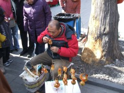 Artist creating blown candy animals at the Dong Yue Temple Fair
