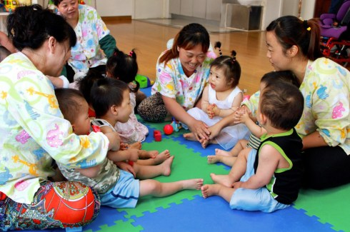 Children and Ayis playing together at China Little Flower.