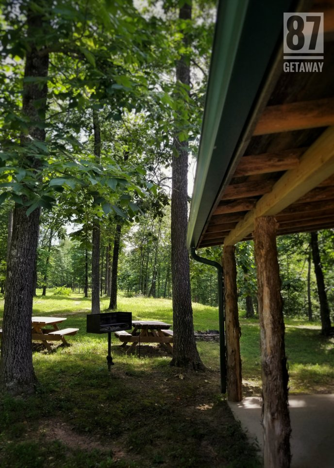 Picnic tables, a fire pit, and charcoal grill for outdoor fun