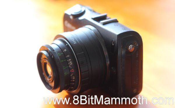 A photo of a Canon EOS M camera with an adapter and Industar 50-2 lens