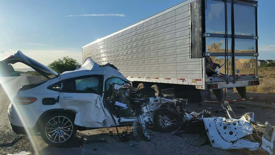 Passenger killed in crash into parked truck trailer