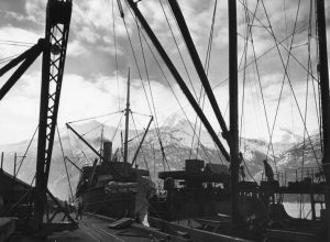 Two ships docked in Skagway Harbor, a challenging task with the 20 foot tides. 1942