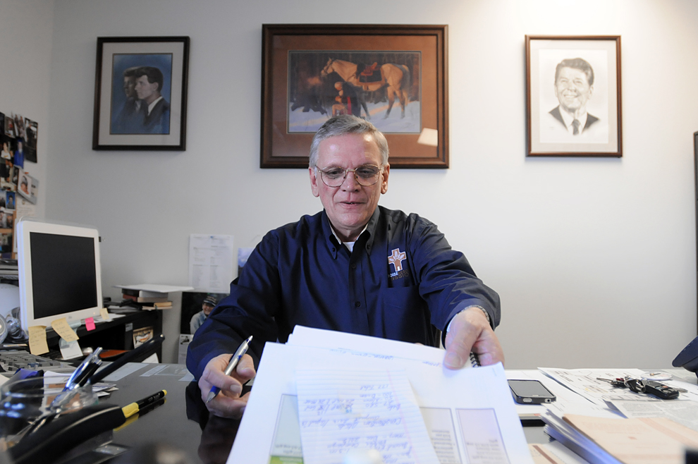 Charlie Litchfield/IPT Rev. Bill Roscoe, executive director of the Boise Rescue Mission works from his desk on Tuesday, Feb. 14, 2012 at the BRM headquarters in Boise.