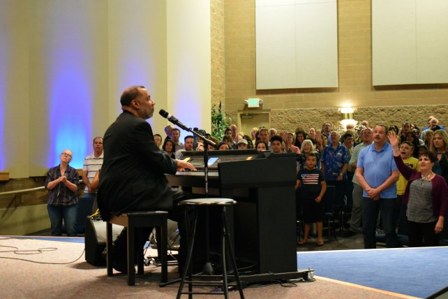 Pastor Paul Sheppard leads the church in worship before teaching.