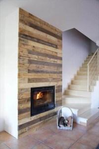 Pallet Wall Surrounding Faux Fireplace