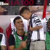 Ronaldo makes young fan's day as he invites him to sit with Juventus bench