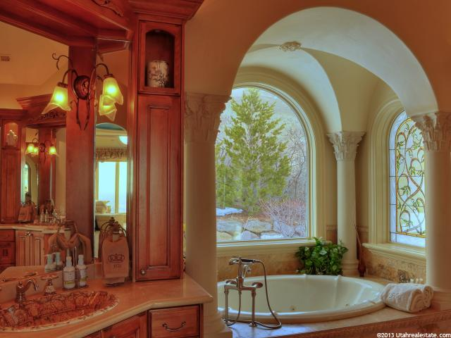 Highly decorated bathroom with oval tub