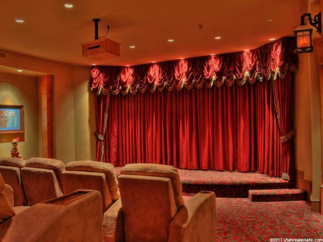 Theater with red draperies over movie screen