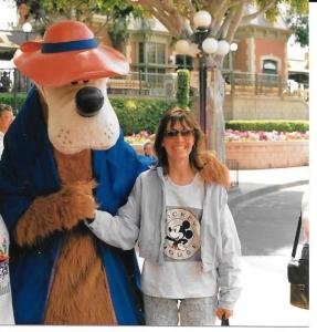 This is me back when I was a real mom. My son is on the other side of Goofy, but I had to cut his picture out to keep my promise of not  posting his picture on the Internet.