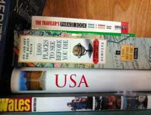 In this stack of books is the book that implies that you must see 1,000 splendors before you die.