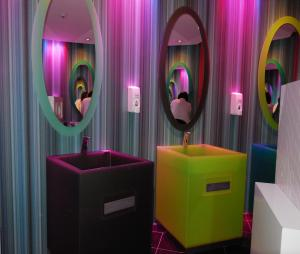 """This is the bathroom at the Cork International Hotel. You can trip out while washing your hands. You can't help but say """"Groovey."""""""