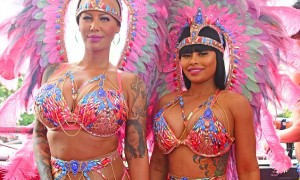 Blac Chyna and Amber Rose light up the streets of Trinidad in bright carnival outfits. The two BFFs were spotted wearing bright pink traditional carnival chief outfits as they paraded with fellow revelers on the Caribbean island. Pictured: Amber Rose and Blac Chyna Ref: SPL1224268 100216 Picture by: Splash News Splash News and Pictures Los Angeles: 310-821-2666 New York: 212-619-2666 London: 870-934-2666 photodesk@splashnews.com