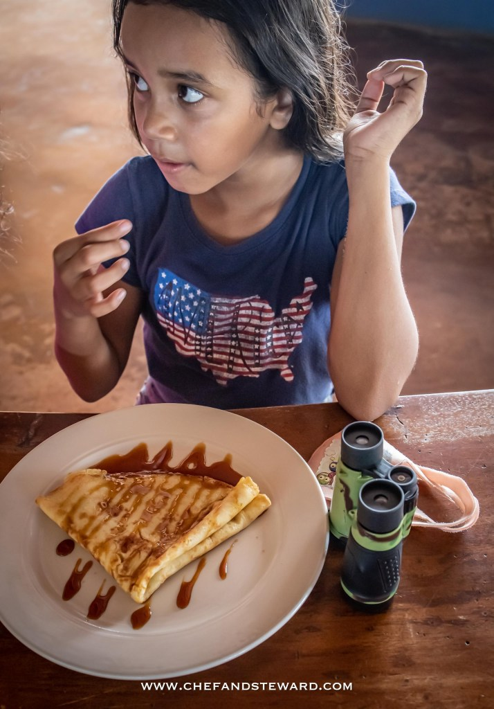 Child eating crepes at Aruba ostrich farm tour what to eat in Aruba off the beaten path