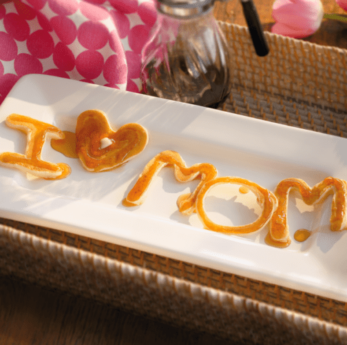 Spell out I love Mom in pancake mix for a great idea for Mother's Day!