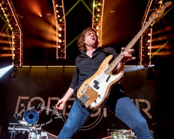 Jeff Pilson of Foreigner doing what he does best, rocking out during the band's performance at Hollywood Casino Amphitheatre in Saint Louis. Photo by Sean Derrick/Thyrd Eye Photography.