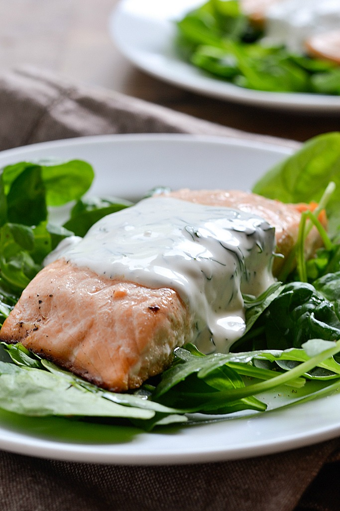 An easy recipe for Baked Lemon Pepper Salmon topped with a Creamy Dill Sauce ready in 30 minutes