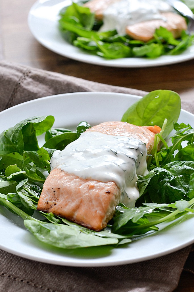 An easy recipe for Baked Lemon Pepper Salmon topped with a Creamy Dill Sauce ready in 30 minutes.
