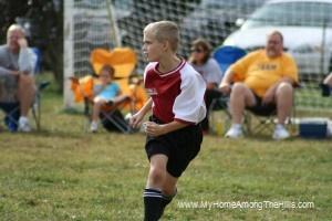 Isaac playing soccer